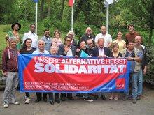 Gruppenbil der Kollegen aus den Migrationsausschüssen mit Frank Bsirske