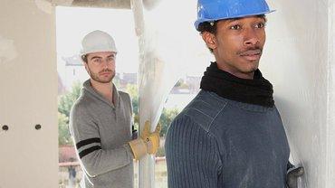 Bild von Colourbox mit Arbeitern mit Migrationshintergrund